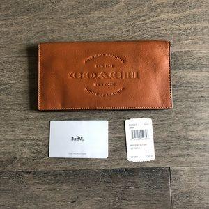 Genuine Coach saddle leather wallet